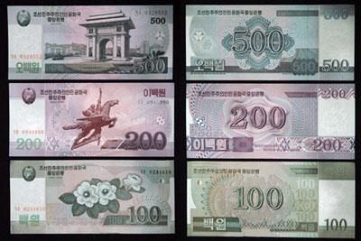 2009年12月4日に公開された新通貨は5000ウォン紙幣から1銭硬貨まで全14種類。(朝鮮中央通信より)