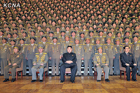 The national meeting of police station chiefs held in Pyongyang on 23 November. Kim Jong-un(Center) and Jang Song-thaek(Rightmost).It is said that the execution of police officers took place after this meeting.(Nov/2013 - PHOTO:KCNA)