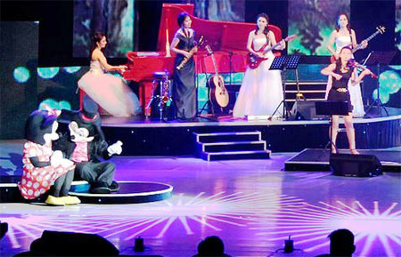 Mickey Mouse and Minnie on the stage at the Moranbong band show. The band is composed of young women. It is said the band was newly formed under the considerable prodding of Kim Jong-un. Among the songs to garner applause from the Dear Comrade, were some American songs performed by mini-skirt clad singers. (June.2012 PHOTO: KCNA)