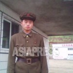 "A member of the ""Worker-Peasant Red Guards"" stands in front of the entrance to a state run enterprise. (Taken by Kim Dong-cheol, South Pyongan Province, October 2010.) . ASIAPRESS"