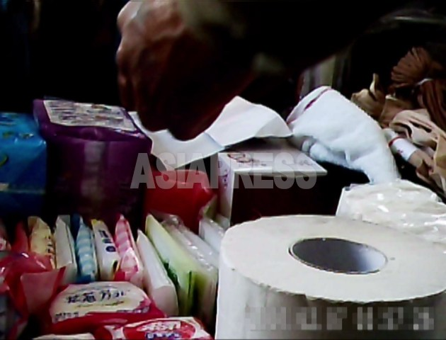 Items such as toilet paper are sold at Moran market in central Pyongyang. All these are from China. (Taken by Koo Gwang-ho/Asia Press on June 2011)