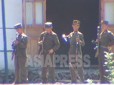 Border guards are on the lookout for smuggling and defection. Border guards checking their equipment prior to their rotation. Taken on August 2004 at Chinese side of upper Tumen River. (ASIAPRESS)