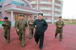 """Kim Jong-un inspecting the newly established large-scale orphanage while smoking a cigarette. Quoted from """"Rodong Sinmun"""", a propaganda outlet of North Korea on January 2015"""